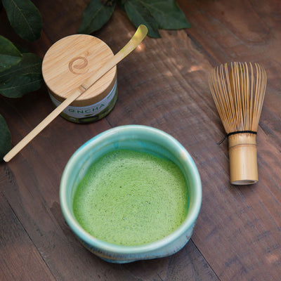 Matcha tea after whisking Encha powder from glass jar