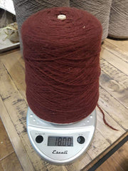 Random Cones of Bison yarns The Buffalo Wool Co. #3 Burgundy Earth (90% bison 10% nylon) 1 lb 1600+yards approx