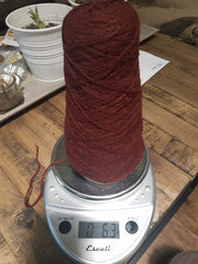 Random Cones of Bison yarns The Buffalo Wool Co. #5 Burgundy Earth (90% bison 10% nylon) 6 oz, 600 yards approx