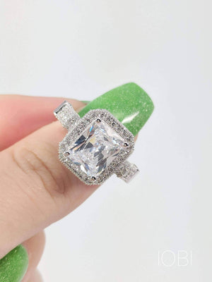 Aurelia 3CT Emerald Cut Halo IOBI Simulated Diamond Ring