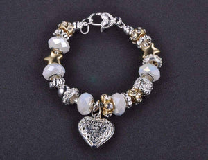 Feshionn IOBI bracelets ON SALE - Pearl White Glass Beads With Heart Charm Bracelet