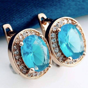 Feshionn IOBI Earrings Blue Topaz on Rose Gold Oval Solitaire Halo Earrings in Sapphire, Emerald, Topaz or White CZ