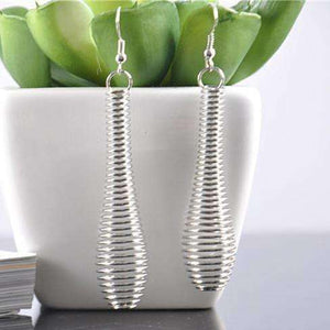 Feshionn IOBI Earrings Silver Coil Drop Earrings in Silver