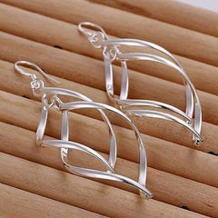ON SALE - Sterling Silver Interlocking Diamond Spirals Earrings