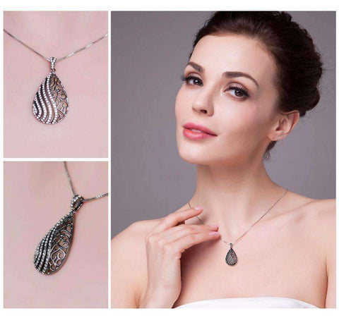 Feshionn IOBI Necklaces Ebony Swirl Black Gold Filigree and CZ Pendant Necklace