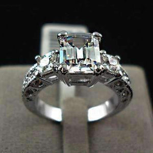 Feshionn IOBI Rings 6 Timeless Three Stone Emerald Cut Swiss CZ Diamond Engagement Ring with Princess Accents - Ring