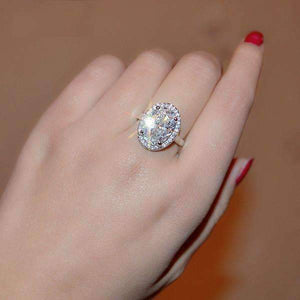 "Feshionn IOBI Rings ON SALE - ""Celebrity"" 6 Carat Oval Engagement Ring in White Gold Plated Halo Setting Ring"