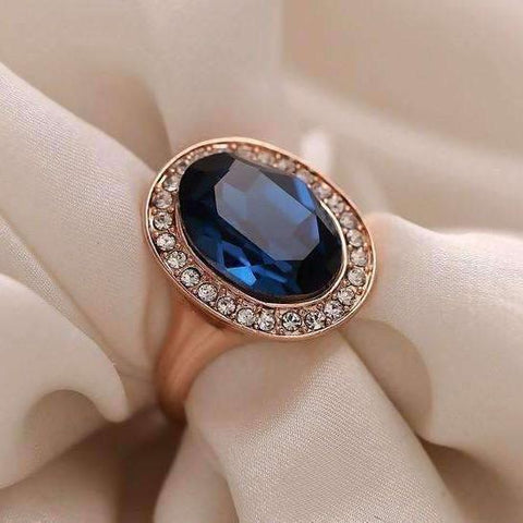 "Feshionn IOBI Rings ""Rhapsody in Blue"" Classic Oval Sapphire Blue and Diamond Austrian Crystal Halo Cocktail Ring"
