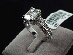 Timeless Three Stone Emerald Cut Swiss CZ Diamond Engagement Ring with Princess Accents - Ring