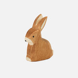 Handcrafted sitting small brown rabbit