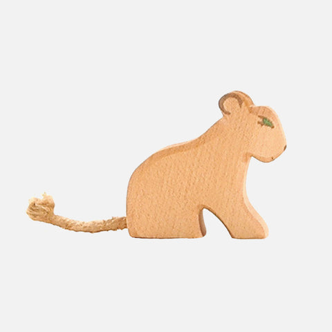 Handcrafted small sitting lion cub