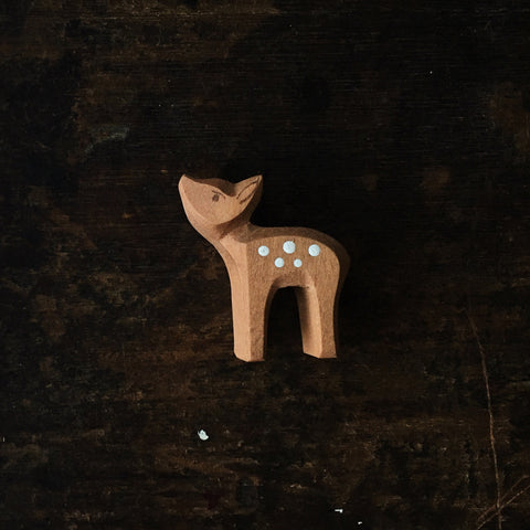 Handcrafted small Fawn looking up