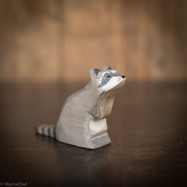 Handcrafted sitting raccoon