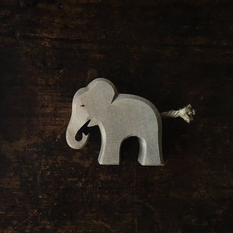 Handcrafted small eating baby elephant