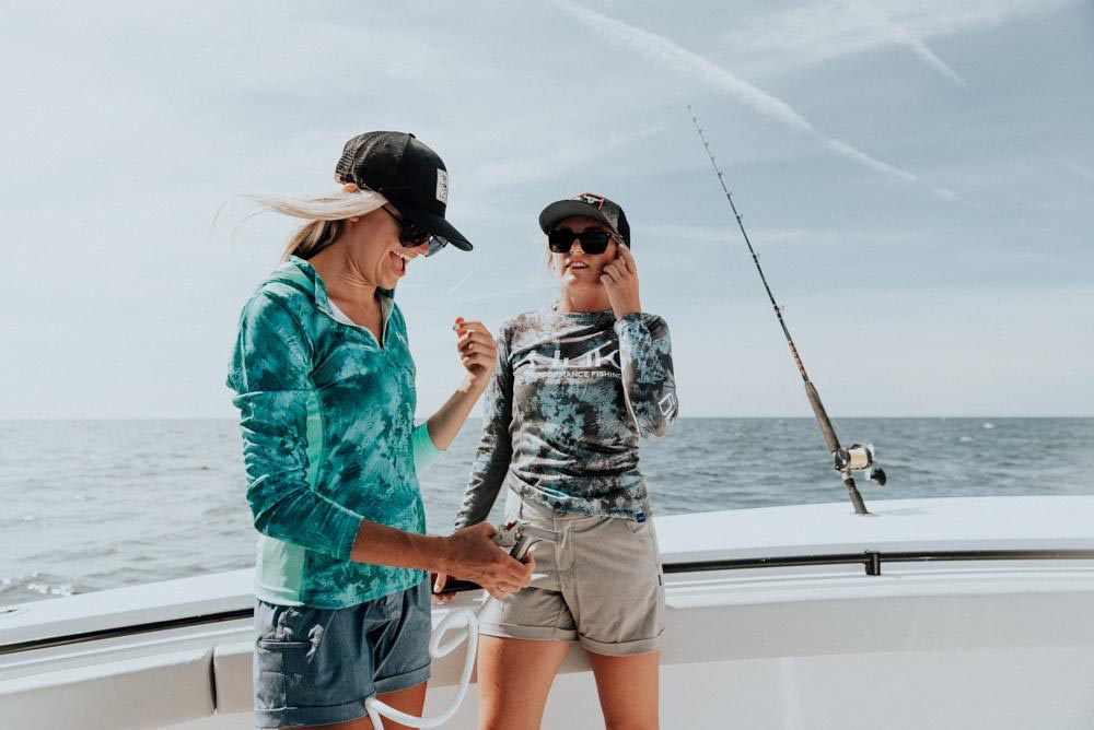 pair of women fishing on boat