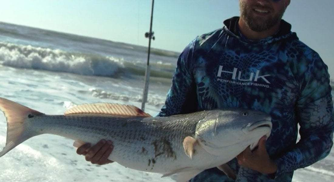Angler Surf Fishing Redfish