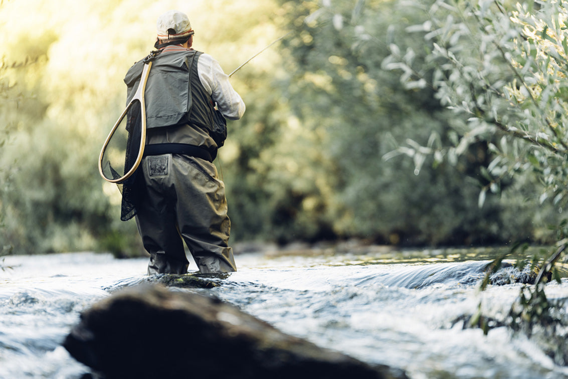 fly fisherman using rod