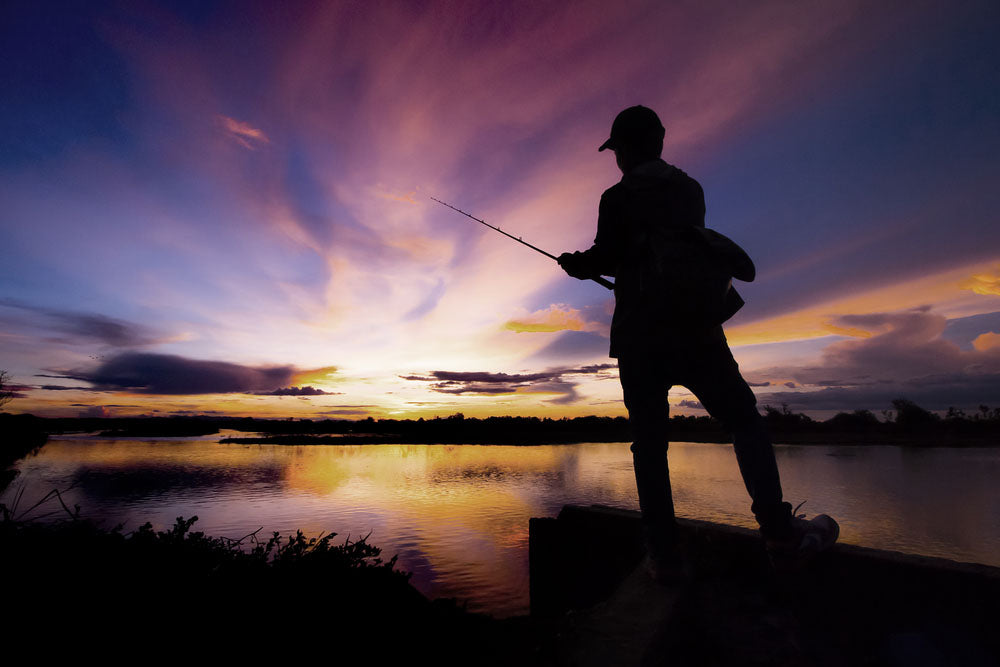 man holding fishing pole