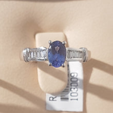 Load image into Gallery viewer, 0.71ct Oval Cut Tanzanite | 0.20cts Emerald Cut Diamonds | Designer Ring | 18kt White Gold