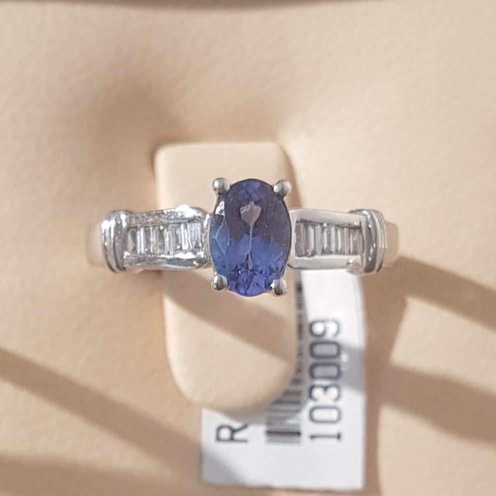 0.71ct Oval Cut Tanzanite | 0.20cts Emerald Cut Diamonds | Designer Ring | 18kt White Gold