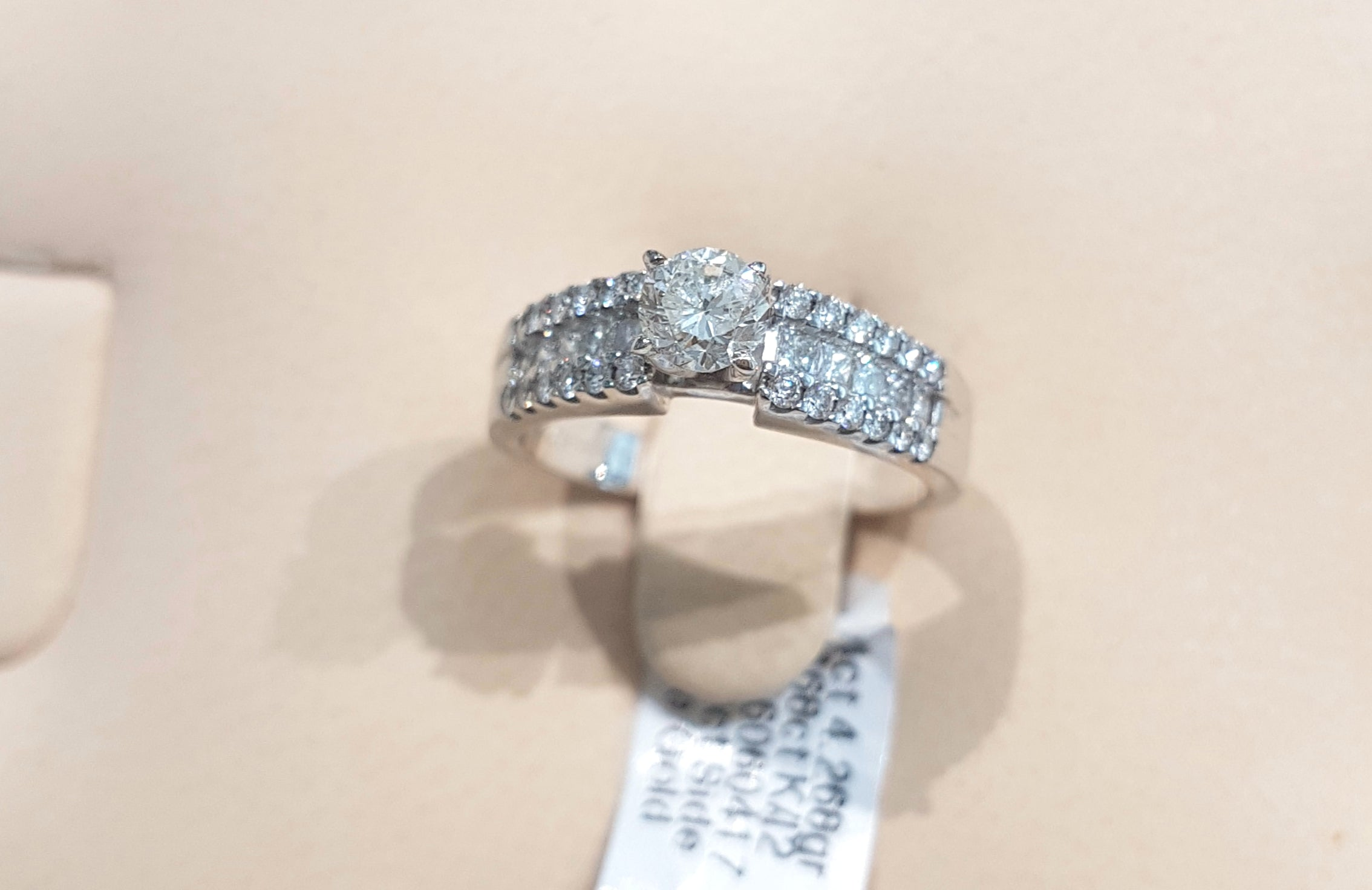 0.468ct [Centre] | 0.520ct Round / Princess Cut Diamond Ring| set in 14kt White Gold.