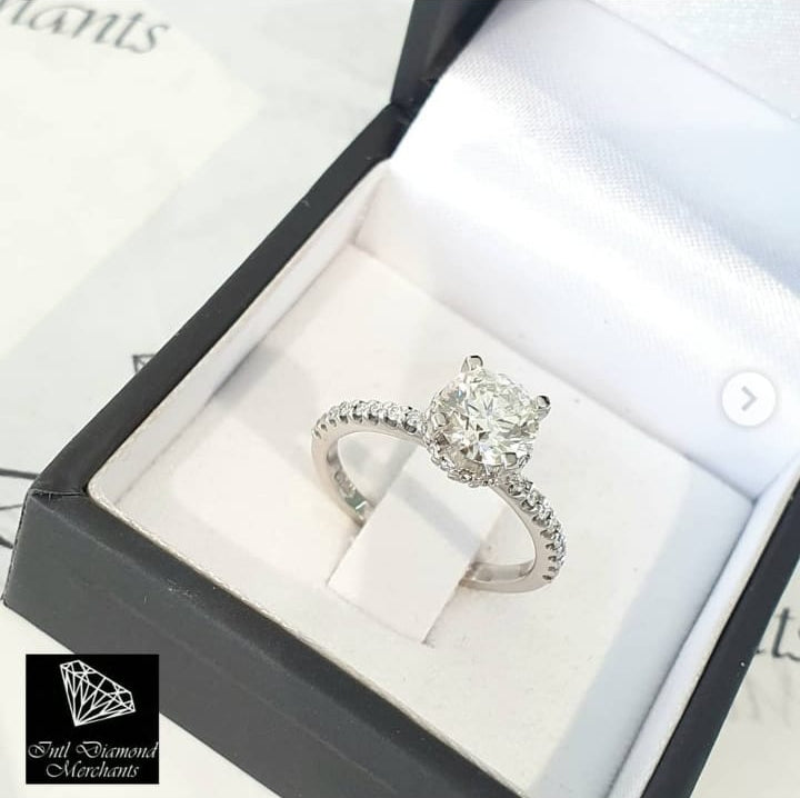 1.054ct Round Brilliant Cut Diamond | 0.30ct [36] Round Brilliant Cut Diamond Halo and Sides | Designer Ring | 18kt White Gold