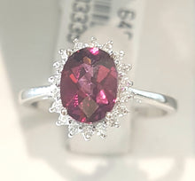 Load image into Gallery viewer, 1.25ct Oval Cut Garnet | 0.20cts Round Brilliant Cut Diamonds | Halo Design Ring | 14kt White Gold