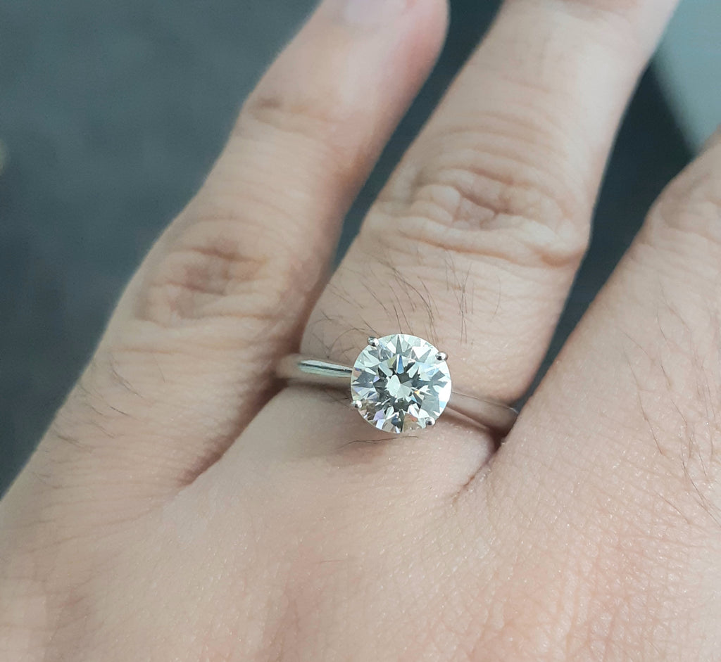 1.05ct Round Brilliant Cut Diamond GIA Certified Centre | 0.03ct Round Cuts Under Collet | Solitaire Design | 18kt White Gold