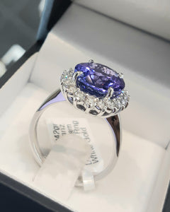 6.10ct Oval Cut Tanzanite | 0.70cts [18] Round Brilliant Cut Diamonds | Designer Ring | 18kt White Gold