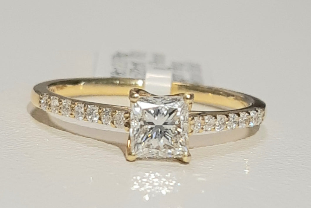 0.522ct Princess Cut Certified Centre Diamond | 0.15cts Round Brilliant Cut Diamonds | Designer Ring | 18kt Yellow Gold