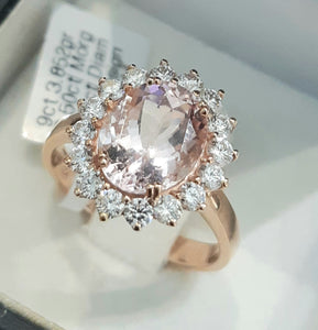 2.50ct Oval Cut Morganite | 0.70cts [16] Round Brilliant Cut Diamonds | Halo Design Ring | 9kt Rose Gold