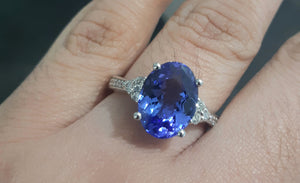 3.00ct Oval Cut Tanzanite Centre | 0.20ct [12] Round Brilliant Cut Diamonds | Designer Ring | 18kt White Gold