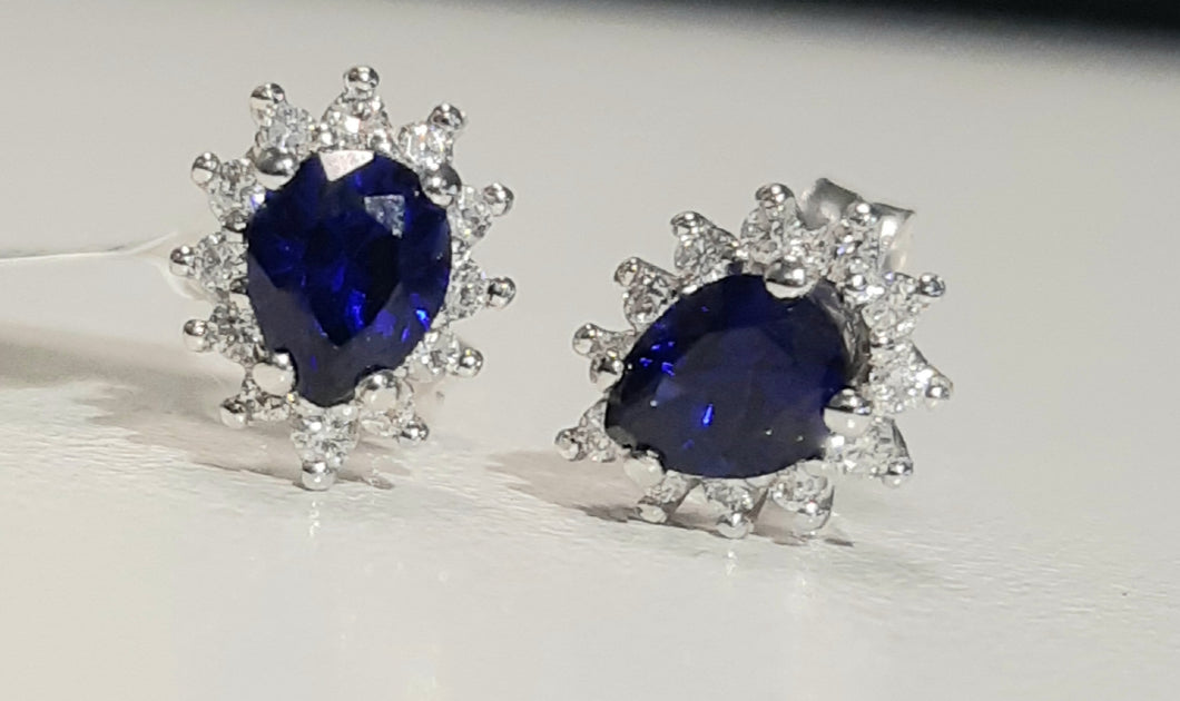 0.78cts [2] Pear Cut Diffusion Sapphires | 0.20cts [24] Round Brilliant Cut Diamonds | Halo Design Stud Earrings | 14kt White Gold
