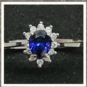 0.40cts Pear Cut Diffused Sapphire | 0.10cts [12] Round Brilliant Cut Diamonds | Designer Ring | 14kt White Gold