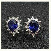 Load image into Gallery viewer, 0.78cts [2] Pear Cut Diffusion Sapphires | 0.20cts [24] Round Brilliant Cut Diamonds | Halo Design Stud Earrings | 14kt White Gold