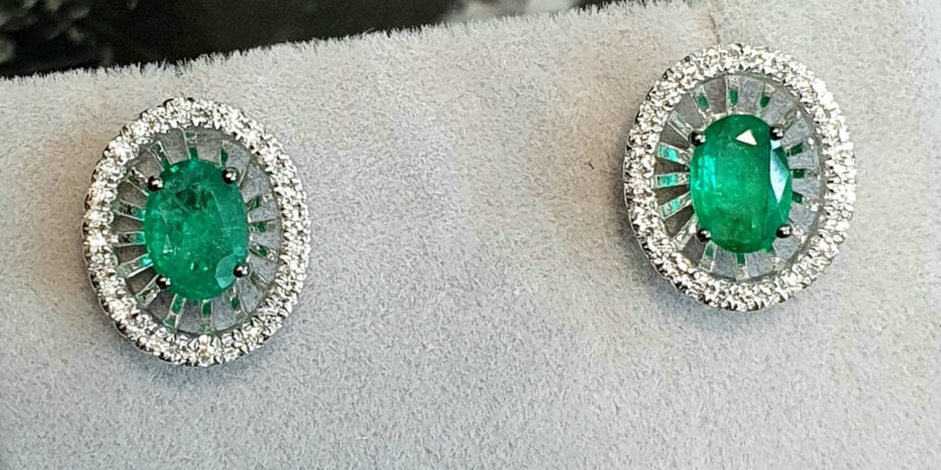 1.24cts [2] Oval Cut Green Emerald Gemstones | 0.48cts [56] Round Brilliant Cut Diamonds | Halo Design Earrings | 18kt White Gold