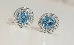 0.45cts [2] Round Cut Blue Topaz | 0.10cts Round Brilliant Cut Diamonds | Halo Design Stud Earrings | 14kt White Gold