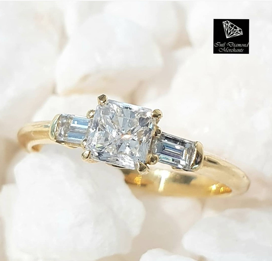 0.688ct Radiant Cut Diamond Centre | 0.30ct Emerald Cut Diamonds | Trilogy Design Ring | 18kt Yellow Gold