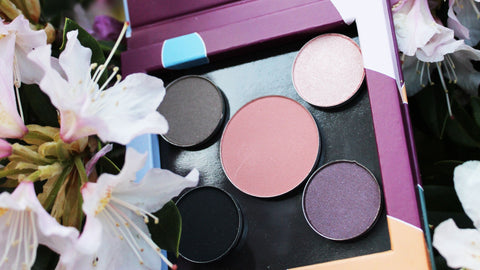 Mix-and-match eyeshadow palette with mineral blush in a refillable magnetic paper compact for makeup