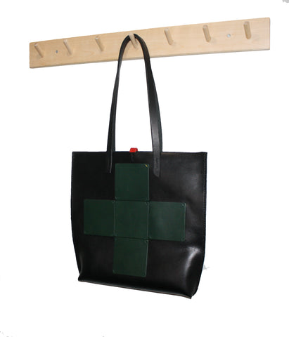 black tote with green cross