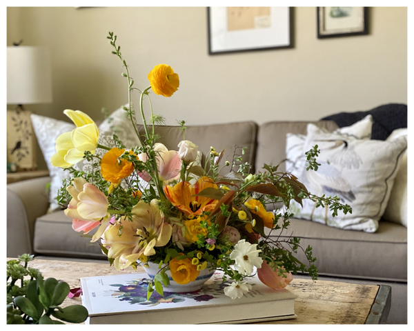A colorful floral display in Paulina's living room