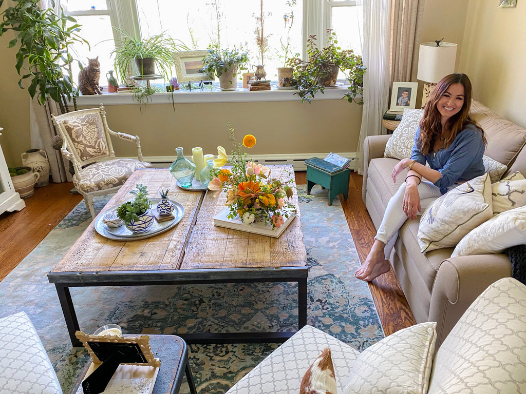 Blue Jasmine Floral owner, Paulina Nielwocki, at home with our Ciato Blue Vintage Modern Rug