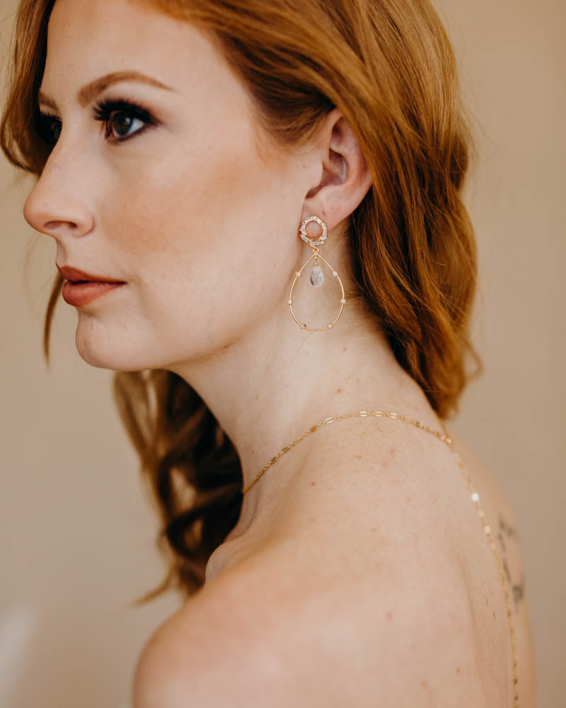 a bride wearing moonstone hoop earrings