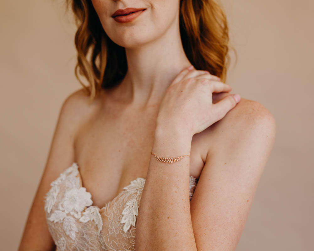 bride wearing leaf bracelet