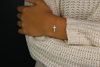 Two Tone CZ Sideways Cross Bracelet