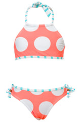 The Neon Spots Halter Bikini is hard to resist for ages 2-16 years. This bikini is the perfect fit with adjustable ties at the neck and coordinating fixed tie bikini bottom. Lined front and back, with striped aqua stripe trim and white dots on neon coral. Match with a short or long sleeve rash top for complete sun protection.  80% nylon, 20% elastane Fully Lined Size 16 had fixed thin bust padding