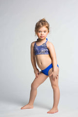 Model is 4 years old and wearing size 4