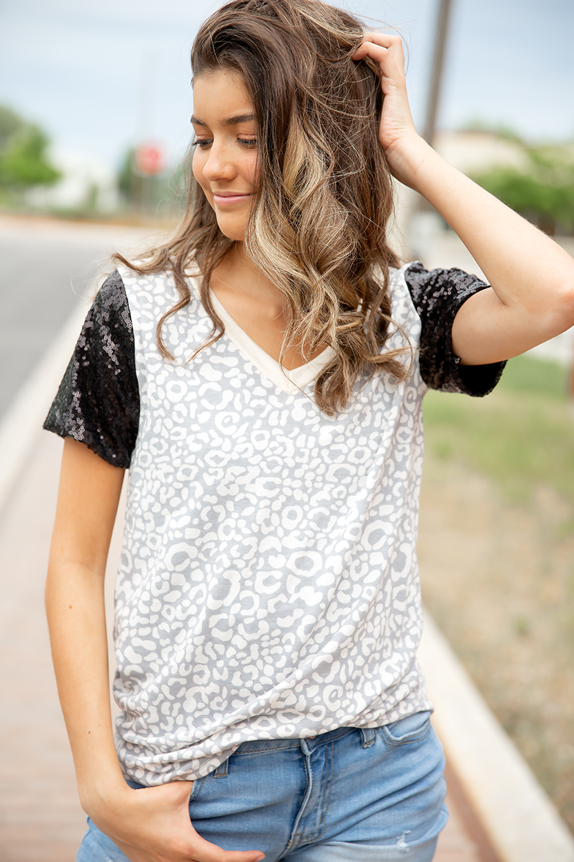 Feeling Fine Animal Print Top with Sequin Sleeves