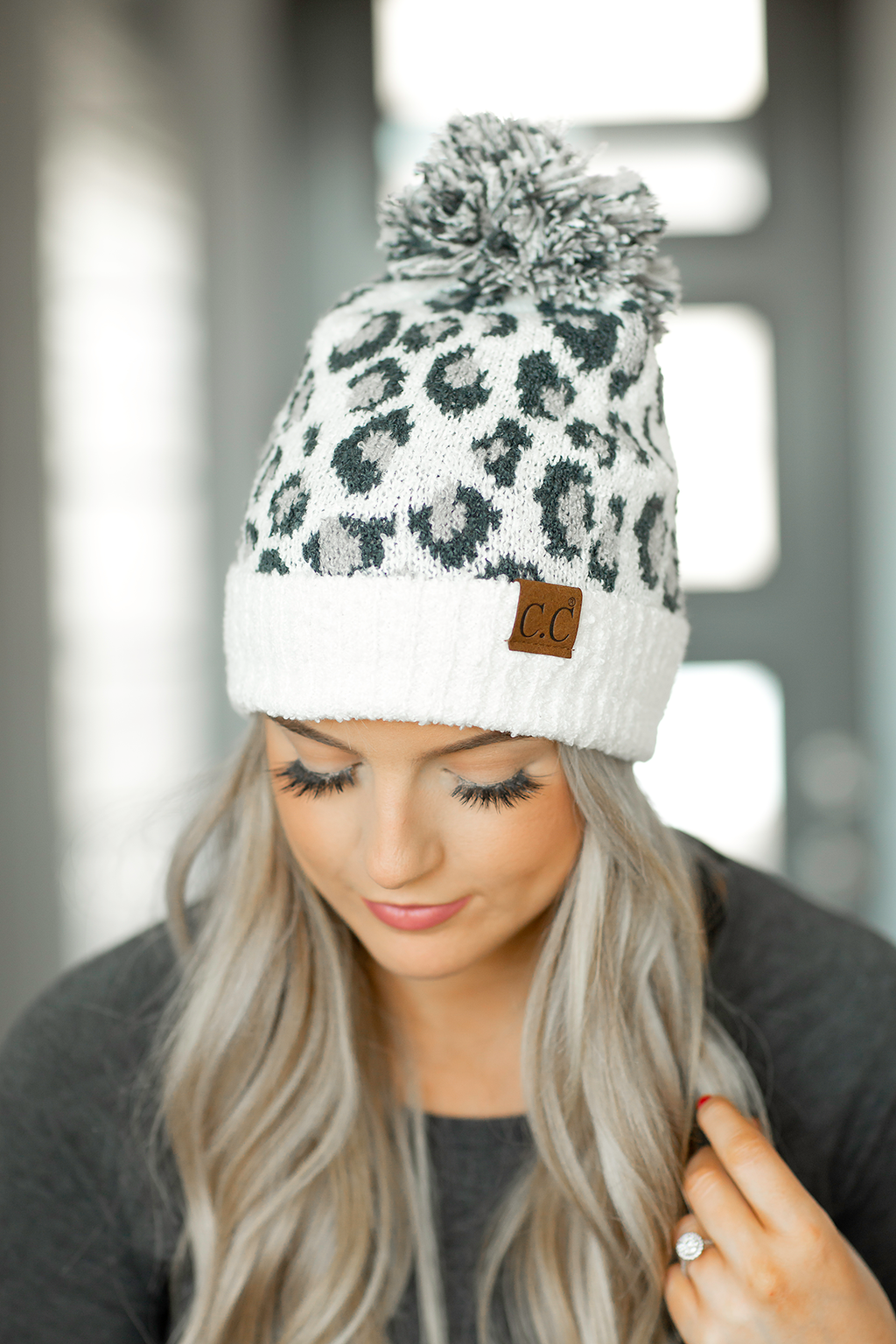CC Knit Pom Beanie in White and Gray Animal Print