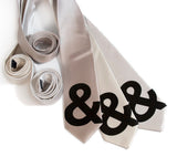 And sign ties. Black on champagne, cream, platinum narrow neckties.